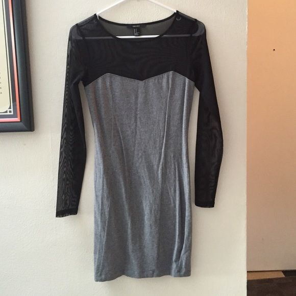 Forever 21 slim fitting cocktail dress See through neckline and arms, cotton material for the rest of it. Excellent condition. Never been worn. Forever 21 Dresses