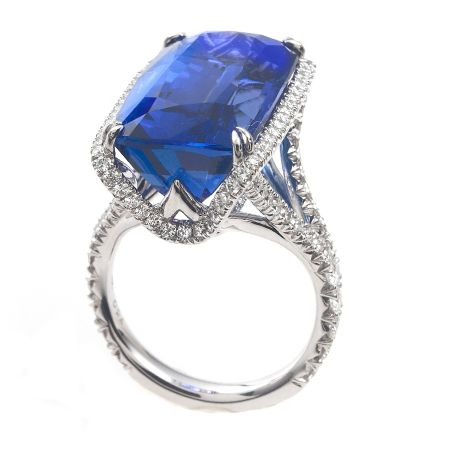 a an in all white women gold diamond brilliant diamonds setting round ring for surrounding it rings centre with cut claw and tanzanite emerald