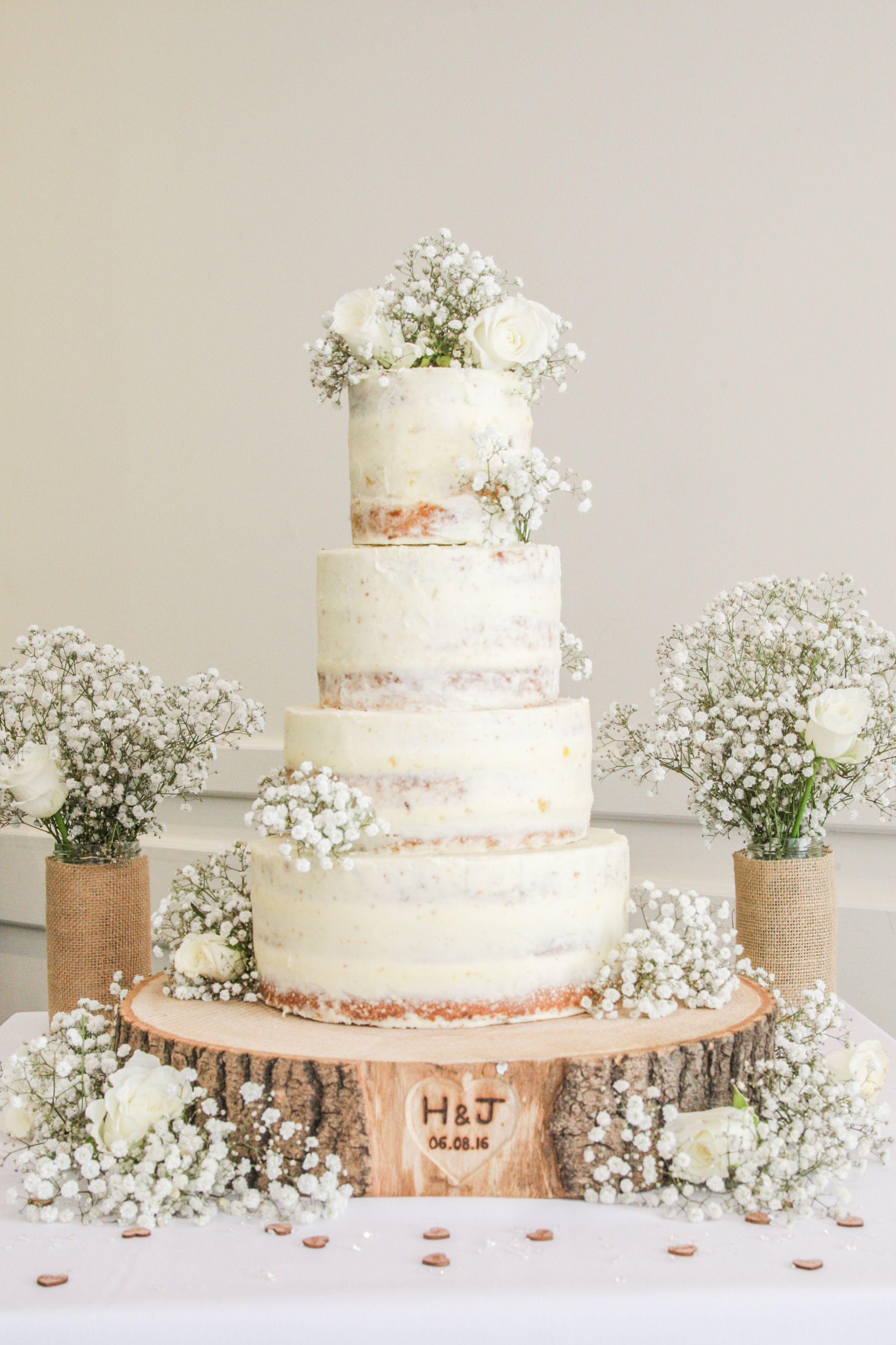 Semi naked limoncello 4 tier wedding cake on a engraved