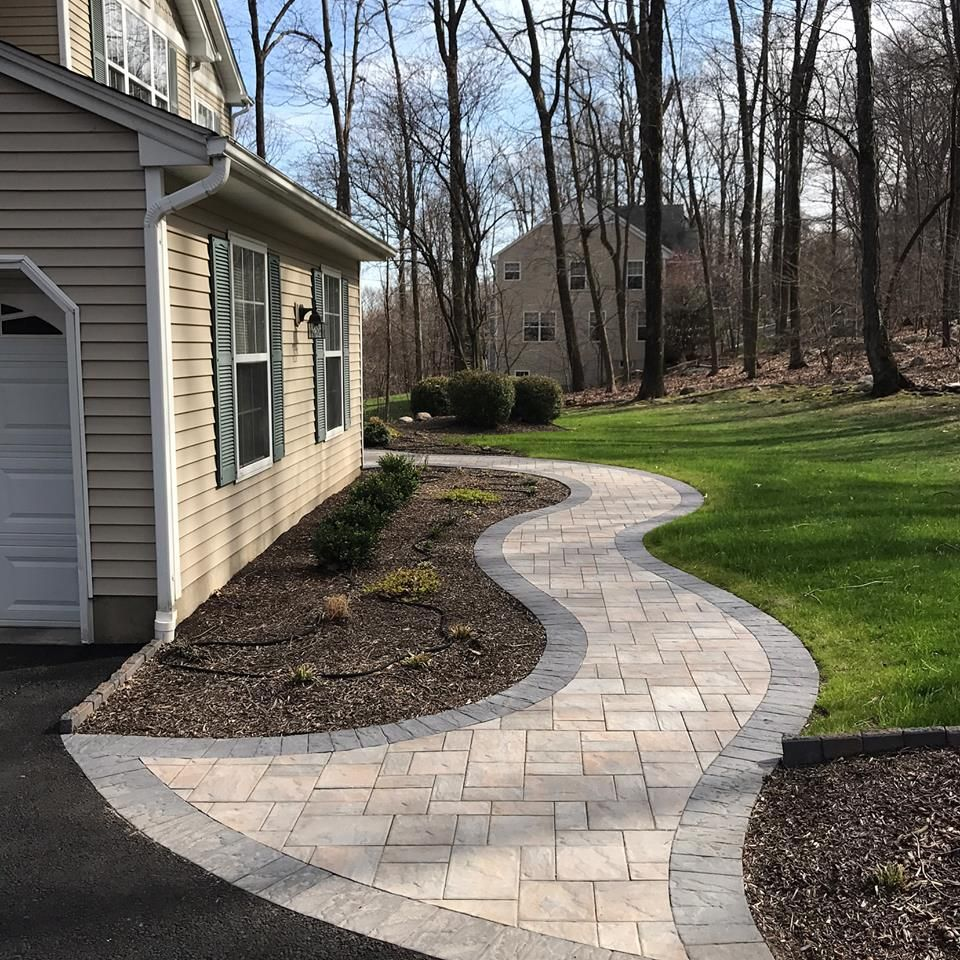 Cambridge paver walkway to the front door serving for Front window landscaping ideas