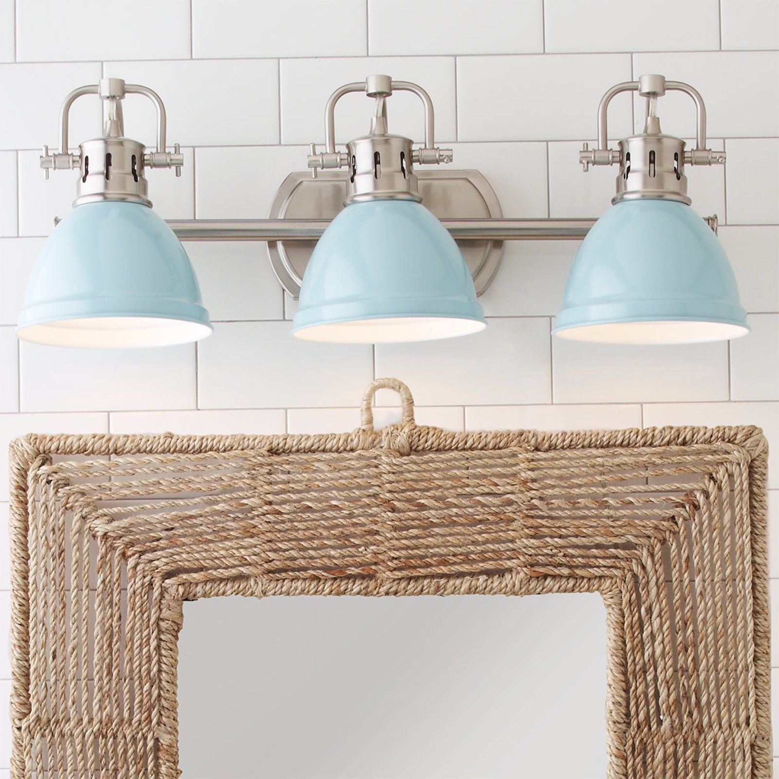 The Duncan Bathroom Vanity Light features a simple classic