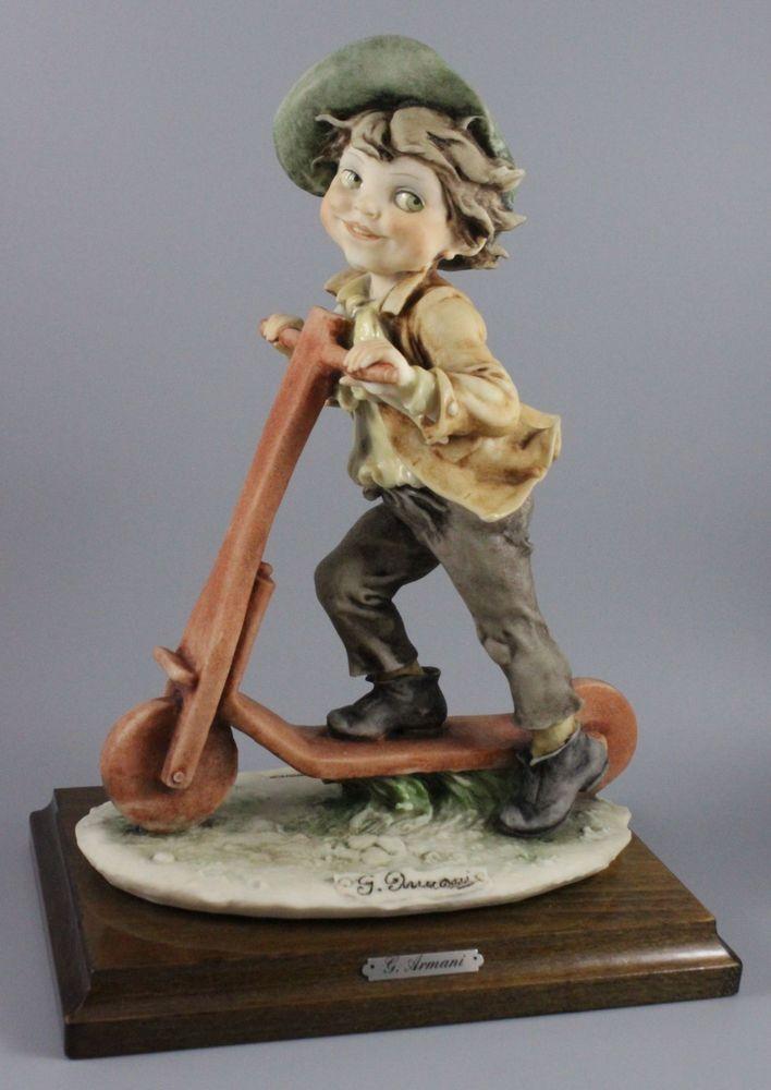 Rare Giuseppe Armani Figurine Boy on Scooter MINT WorldWide