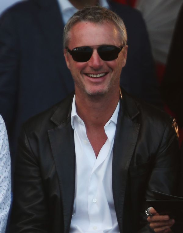 Eddie Irvine wears  (Suit )