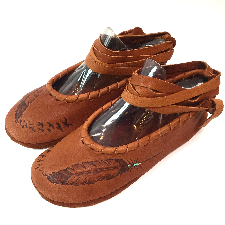 e6426e69f541 #moccflats #artwear #deerskin #flats #moccasins #plains #artisan  #womenswear #comfort #cognac #footwear #birds #feathers #handmade with #love