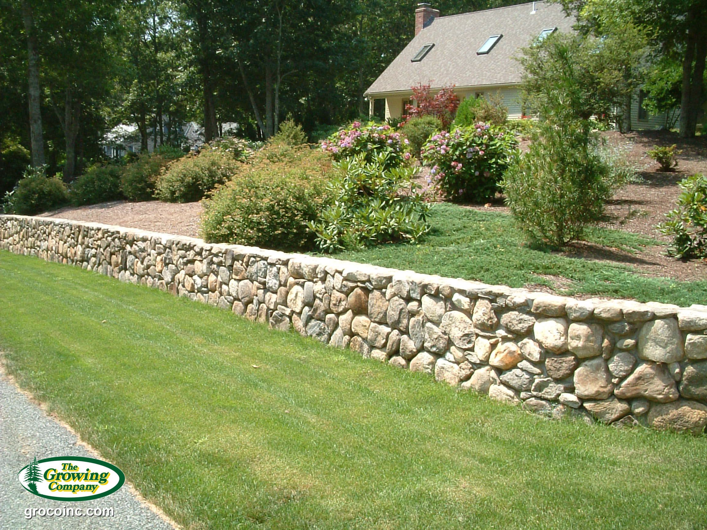 A Natural Stone Retaining Wall Is Both Functional And Decorative