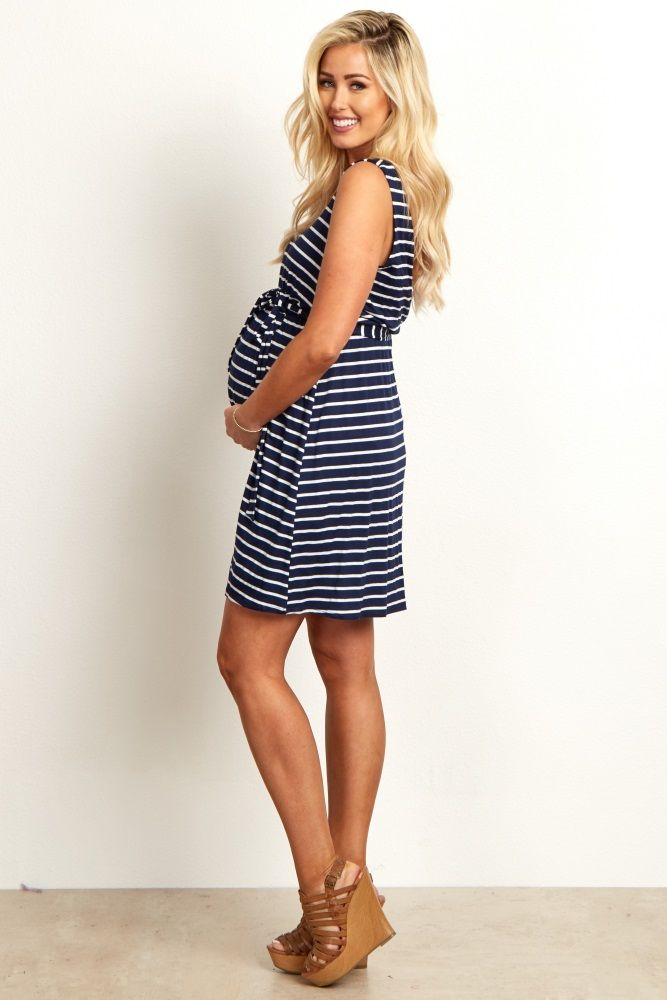 f446656689358 We love this maternity dress that has all out favorite details. A  v-neckline and sash tie detail with a striped print will beautifully show  off your bump ...