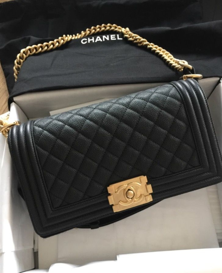14f8da07f69c This Chanel Boy caviar Black and gold is available to purchase online  preowned. Visit Luxury Promise for authentic preowned luxury products.