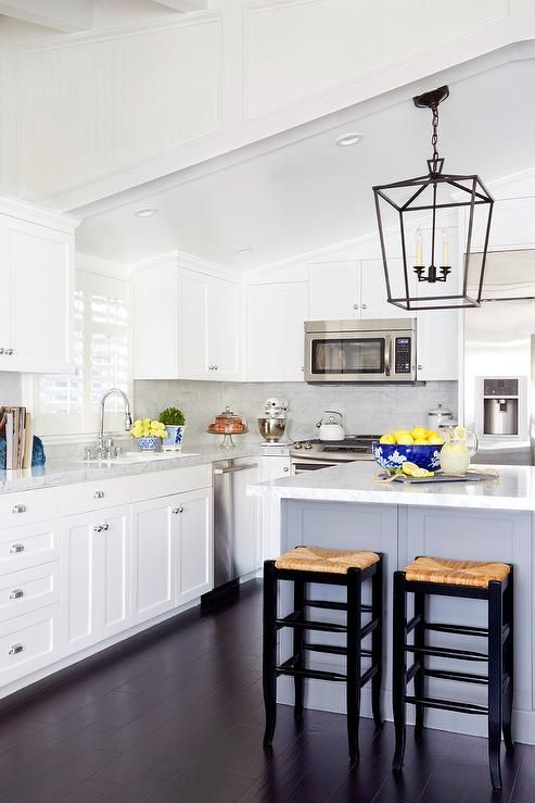A White Sloped Ceiling Stands Over A White Shaker Kitchen Cabinets Paired With Marb Vaulted Ceiling Kitchen Kitchen Remodel Small White Shaker Kitchen Cabinets
