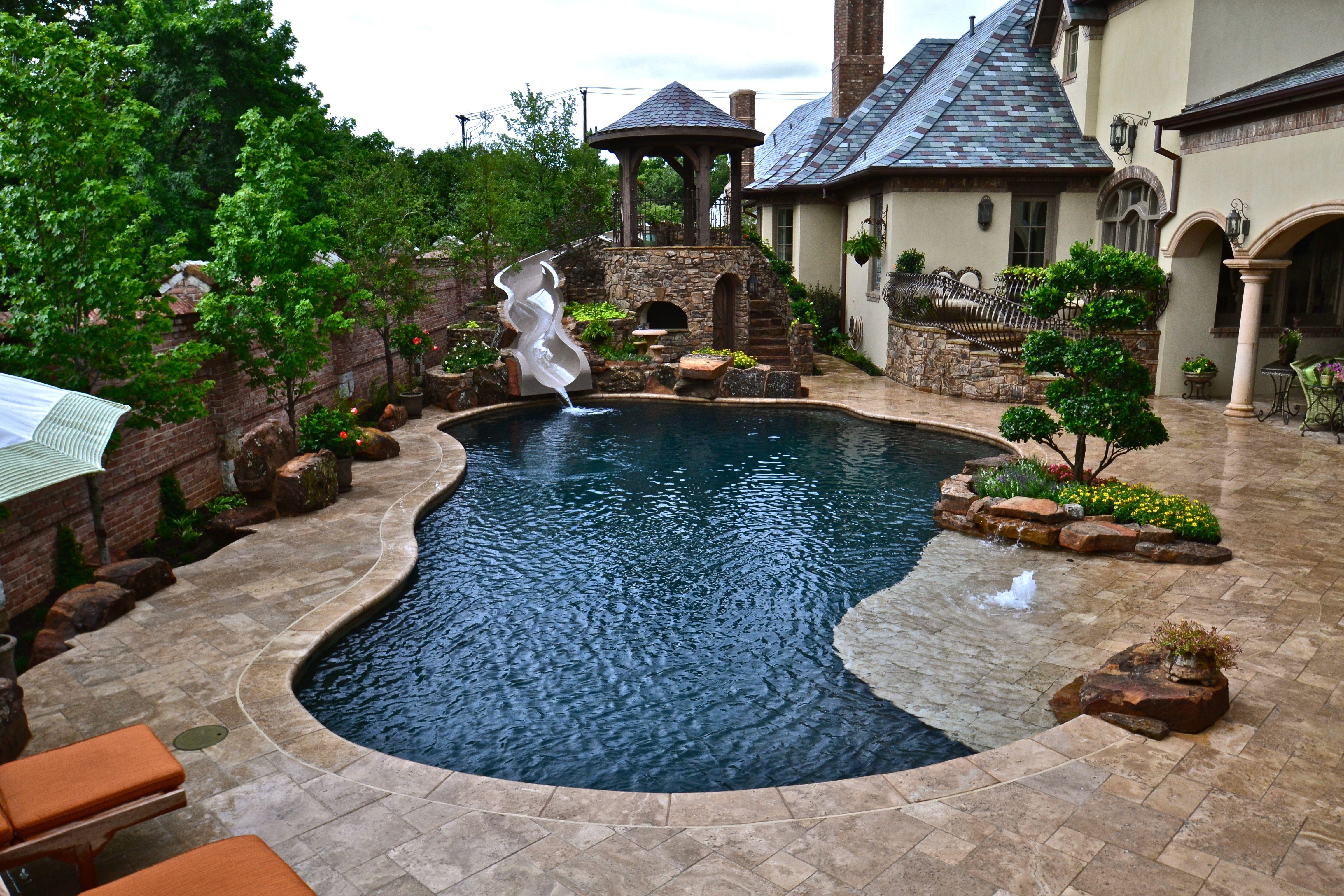 a white malibu pool with a saltfinishedconcrete u0026 a spa