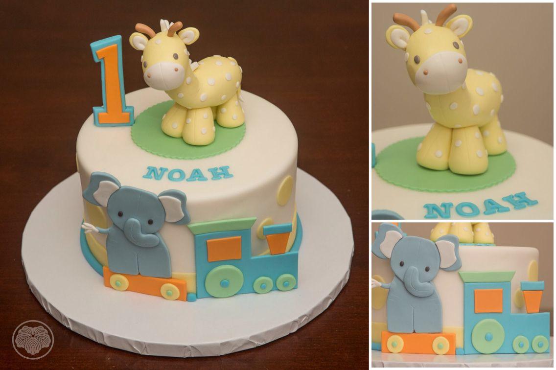 First birthday cake with favorite stuffed giraffe Custom Cakes