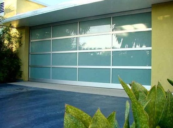 12 Foot Frosted Glass Garage Door With Stainless Frame Home Interiors Modern Garage Doors Garage Door Design Contemporary Garage Doors