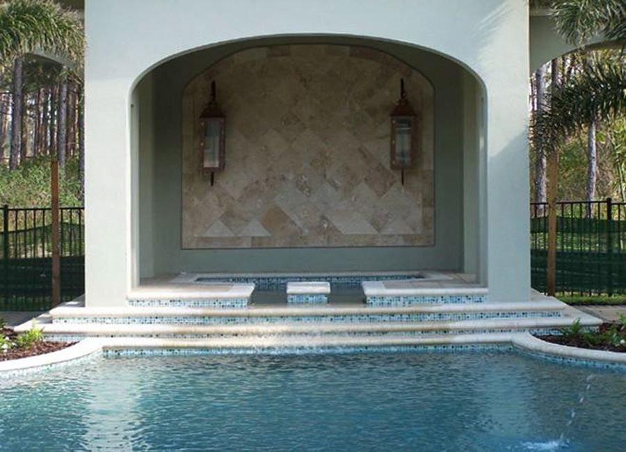 Elegant brown wall inside the niche here, and lovely pool mosaic steps!