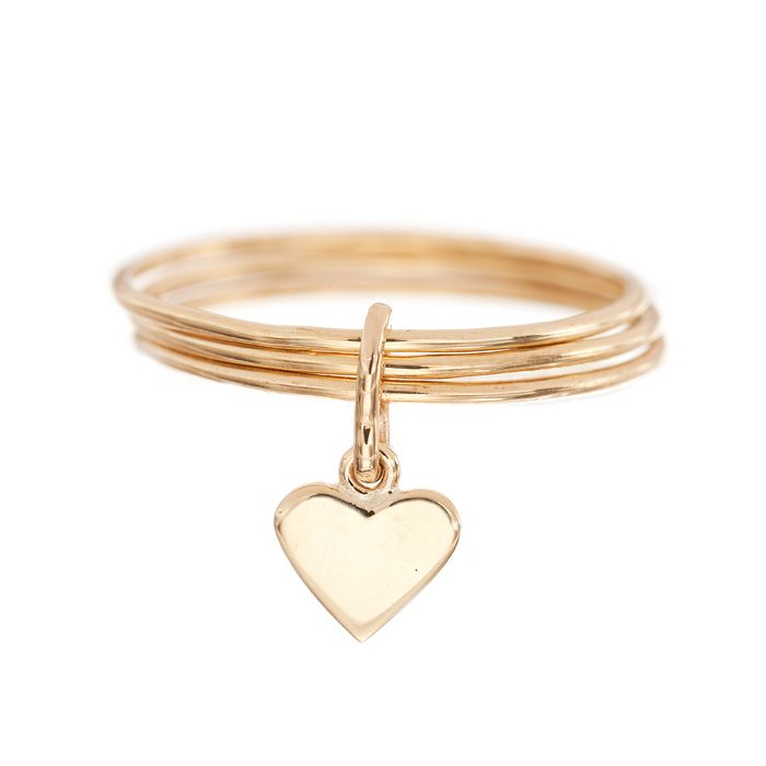 3 delicate gold rings bound together with a dangling heart ...