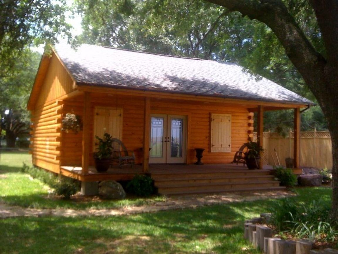 Cheap homes on wheels cheap log cabin kits small log for Micro log cabins