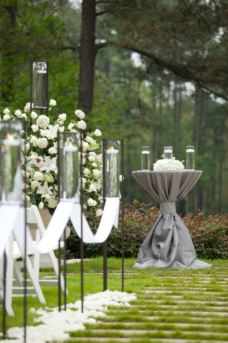 Garden wedding aisle decor  Candles Aisle decor Elegant botanicu  Wedding  Aisle  Altar