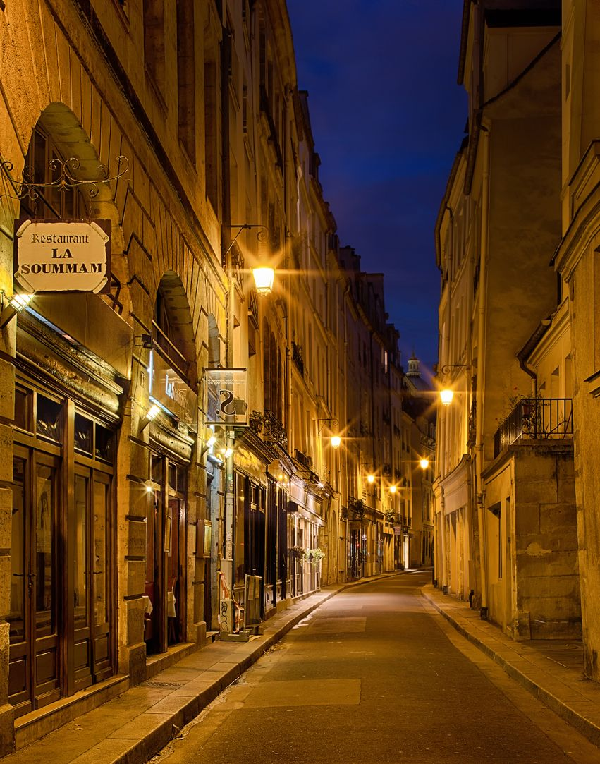 A romantic evening stroll through the smalll streets of the Latin Quarter, in Paris.