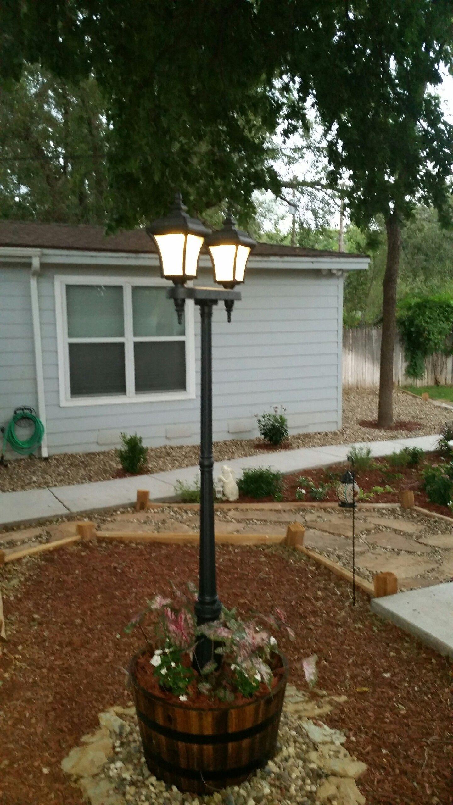 Diy Solar Lamp Post In Whiskey Barrel Diy Outdoor Lighting Cheap Landscaping Ideas Solar Garden Lanterns