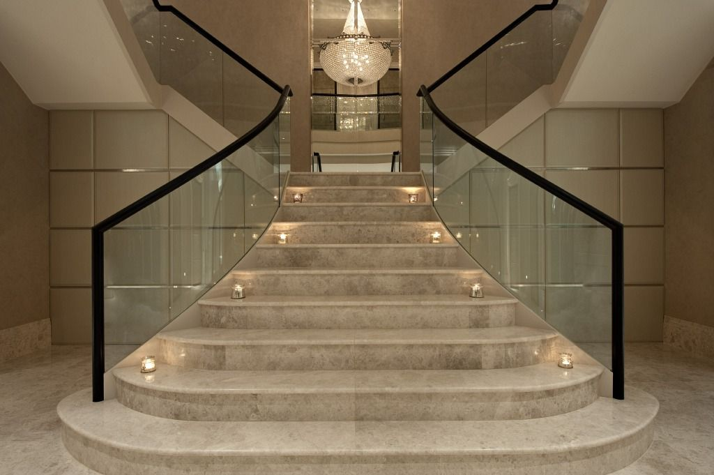 Two specially designed coat cupboards beneath the grand for Staircase ideas near entrance
