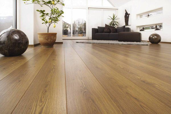 Bamboo laminate flooring is durable and adds warmth to a basement floor.  Materials and Tools: bamboo flooring (amount varies on room) six 2 x feet  long)