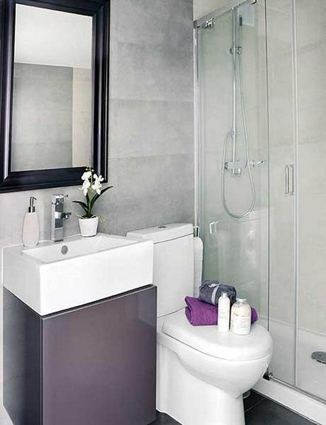 Modern and Minimaist Small BAthroom with Black Framed Mirror and White  Bathroom Countertop and Shower Bath