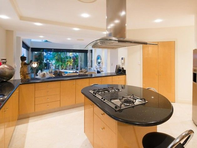 oval kitchen island with black countertop kitchen lighting wood ...