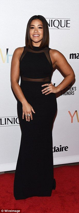 Sheer beauty! The Jane the Virgin star rocked a sexy black gown with see-through panel cut...