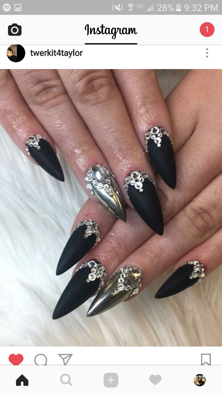 Black Stiletto Nails With One Chrome Silver And Jewels With
