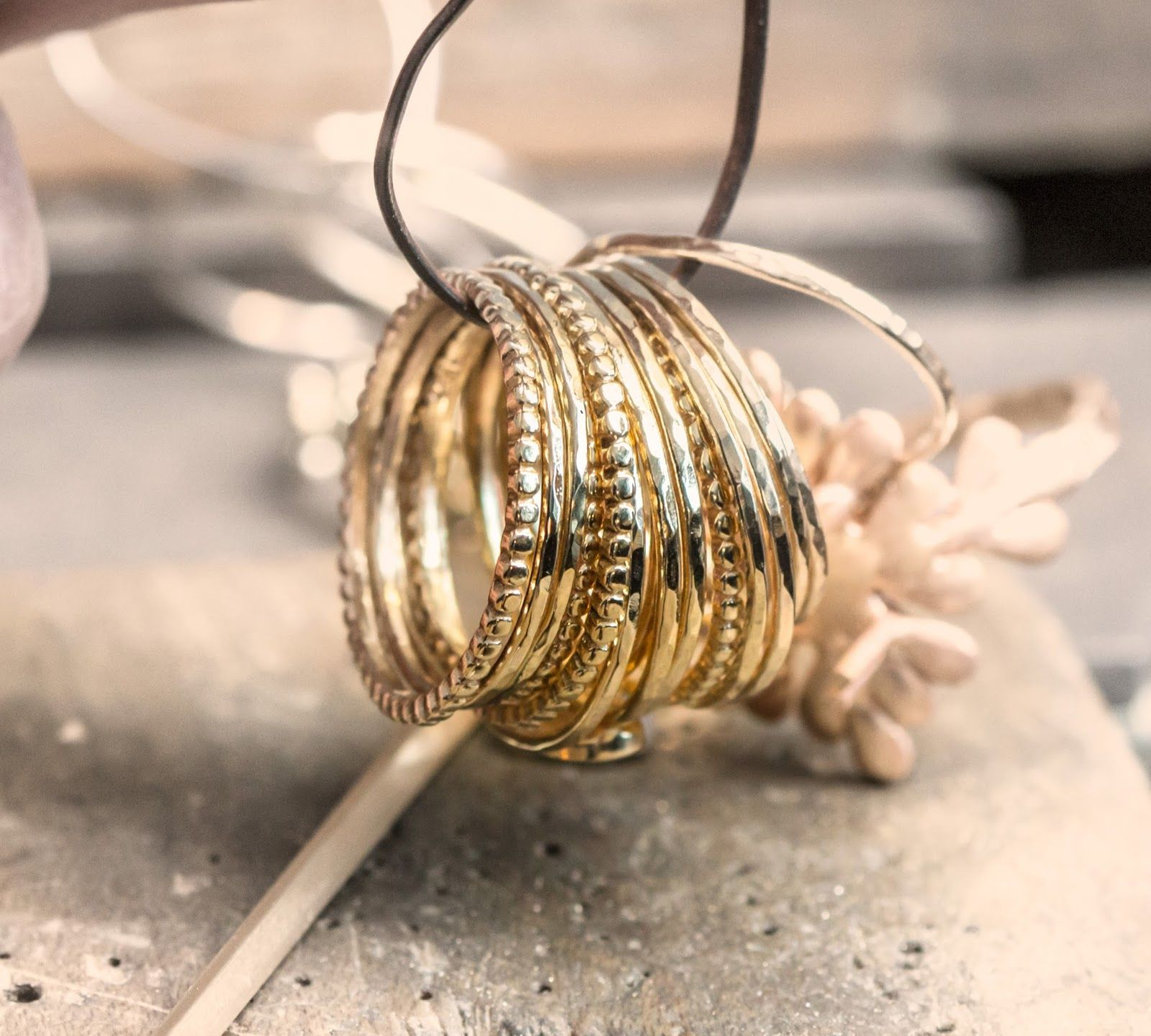 Skinny gold stacking rings by Melanie Casey..... Made me think of that silver set you have!!! @pkinak