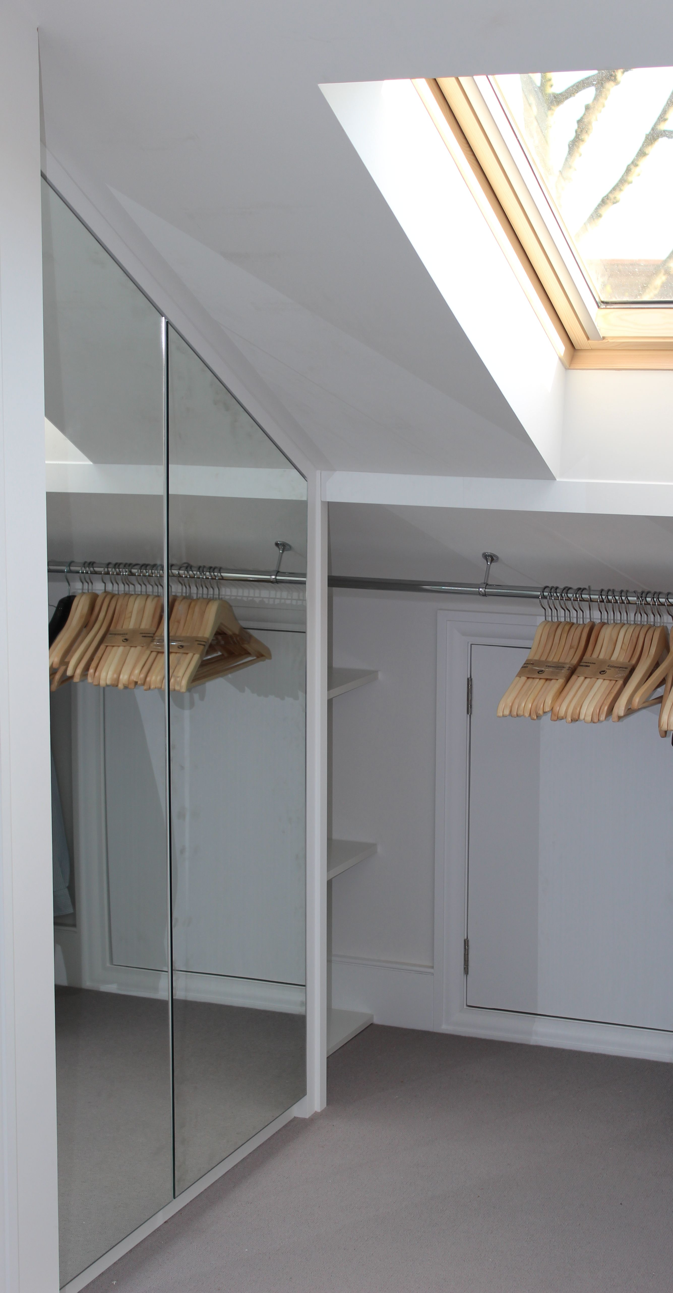 Bespoke made to measure loft wardrobe with mirrored doors for Loft storage room