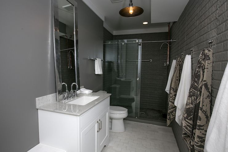 Masculine Bathroom Boasts Dark Gray Walls A Backdrop For White Vanity Topped With White Granite Countertop And L Masculine Bathroom Dark Grey Walls Grey Walls