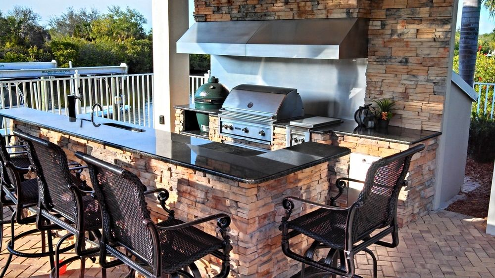 Beautiful Outdoor Kitchen with Black Granite and Stack Stone ...