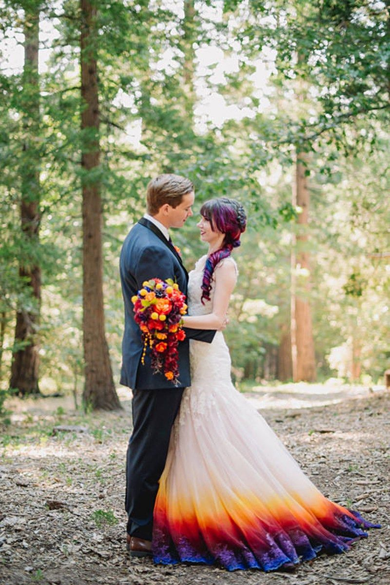 When a hand-airbrushed wedding dress at a colorful forest wedding ...