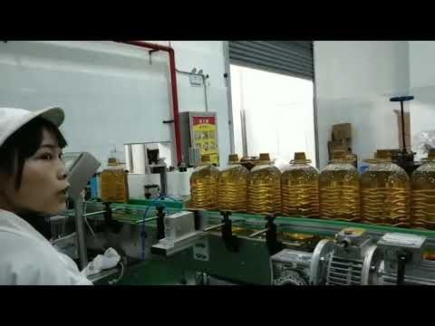 Photo of lubricating mobil motor hydraulic car pump oil bottle filling production line machine