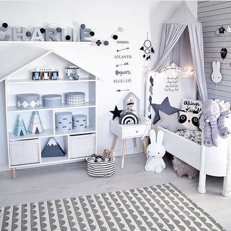 A gender neutral kids room with a whimsical monochrome design theme.