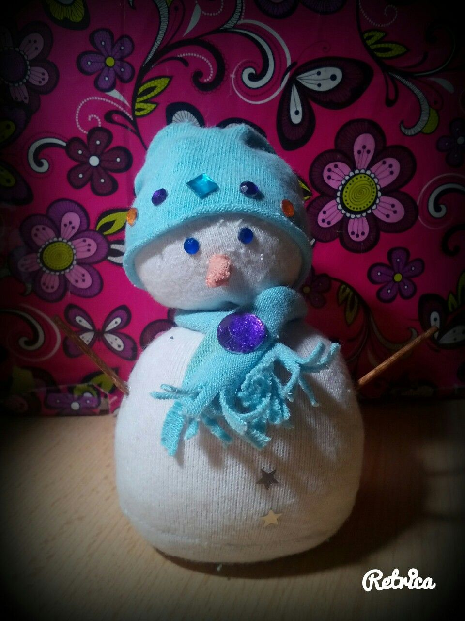 Diy snowman with old white sock and rice+fake gems