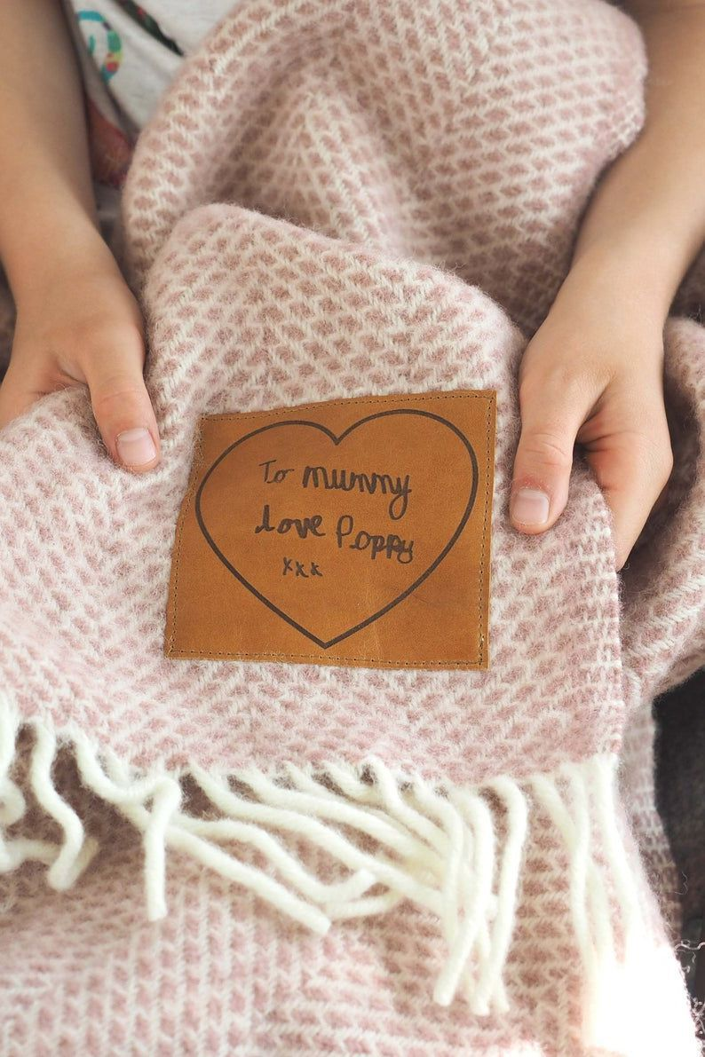 What's even better than finding the perfect gift for your loved ones? A personalized version of it, made just for them like this personalized woolen throw blanket with your custom message.