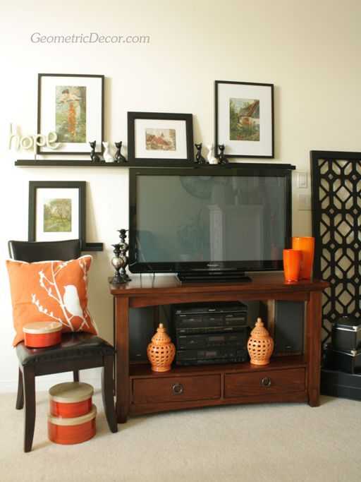 Decorating around a flat screen tv from the tv by for What to hang on wall above tv