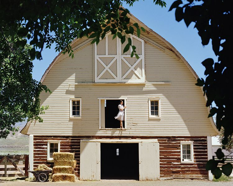 """While this barn was listed as """"Brand-new barn home..."""" on the picture, I take exception to that statement.  You can clearly see that the bottom portion of this barn is old log construction.  Must be a story here."""