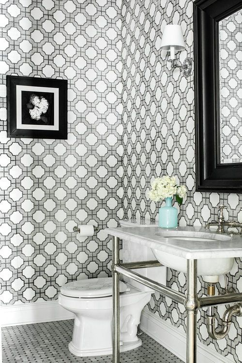 Designer Marisa Lafiosca featured Phillip Jeffries Imperial Gates 5196 Grey and Black on White Manila Hemp in the powder room of a client's home.
