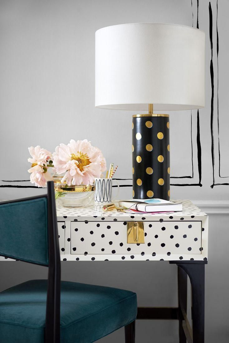 All the Feminine Home Decor Inspo You'll Need for a Ladylike Home - gold and black polka dot lamp styled with a black and white polka dot writing desk + soft pink flowers.