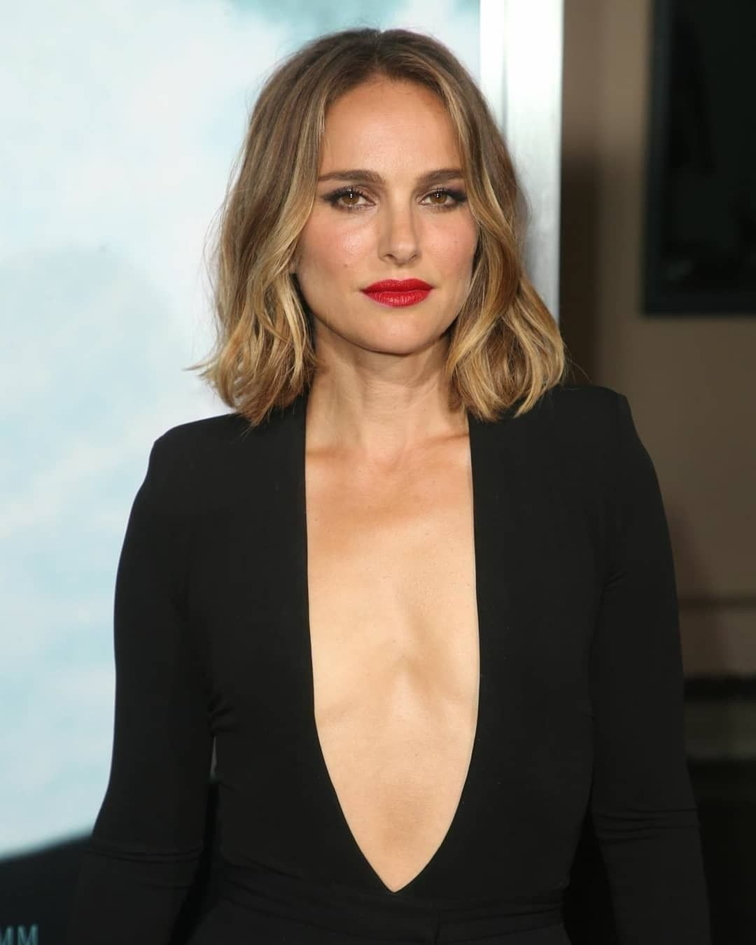 Natalie Portmans Plunging Bodysuit and Miniskirt Outfit