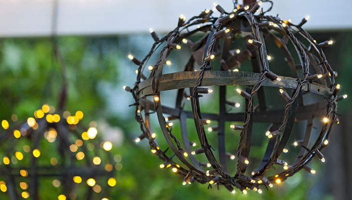 Take those summer/spring hanging baskets, turn upside down and wrap with Christmas lights to ...