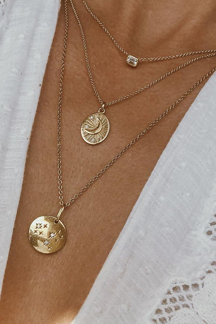 The Emerald Cut necklace, Moon Necklace and Zodiac Necklace via @thiswildpursuit.