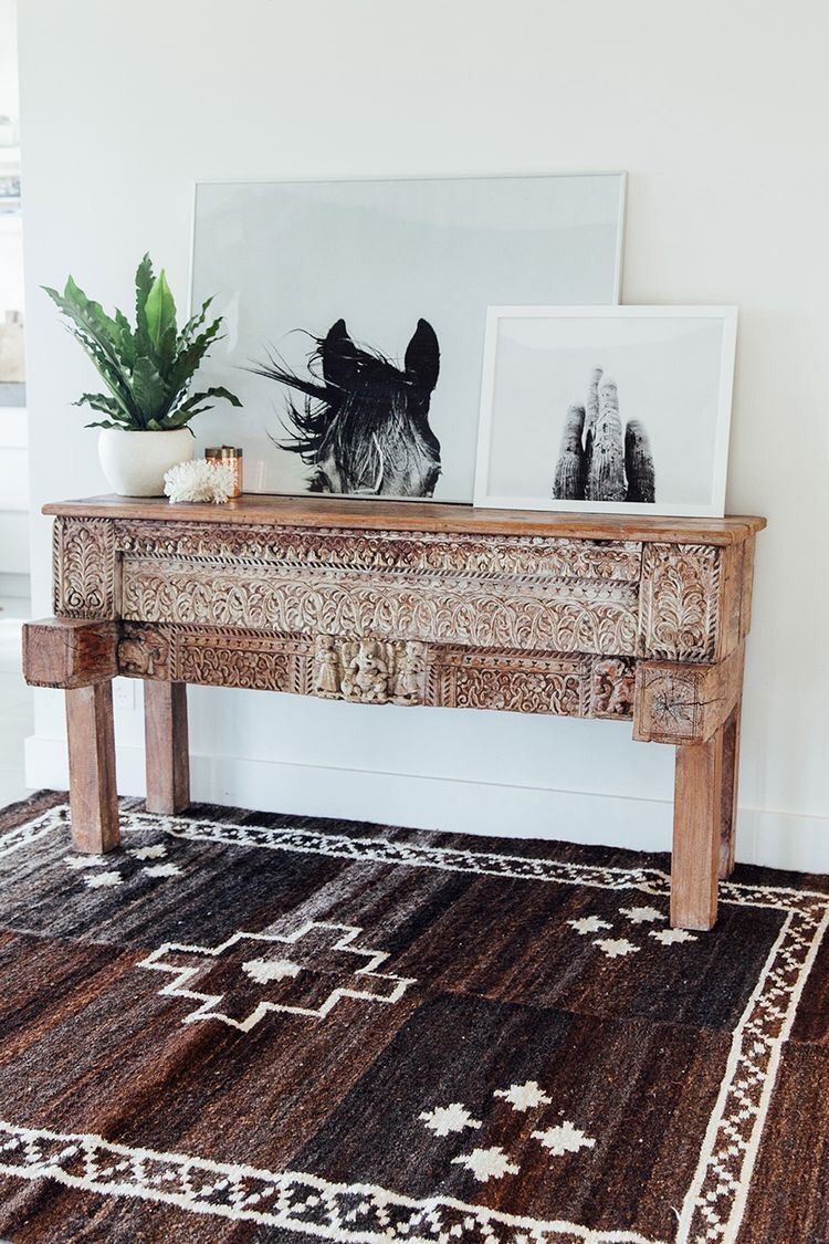 The earthy tribal rug and fine art horse photography really make this entryway stand out i want