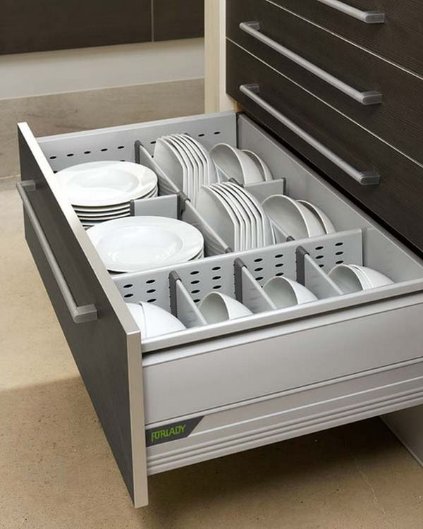 Bottom Kitchen Drawer Featuring Different Sized Storage Compartments For Plates And Bowls