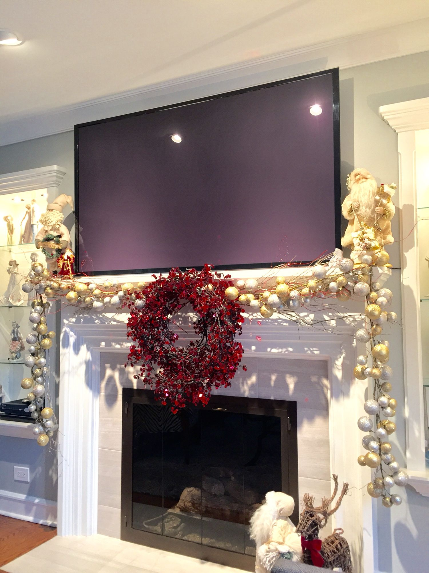 Mantle Decoration For Christmas With A Big Screen Tv Christmas Mantle Decor Christmas Fireplace Decor Christmas Fireplace
