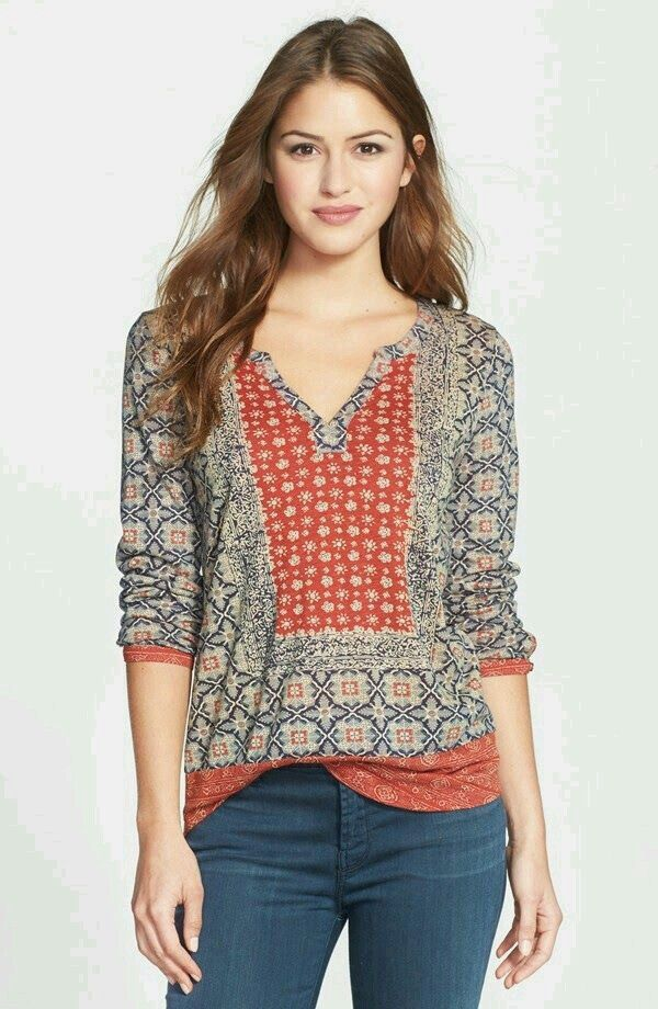 Nice fall top. Like the neckline and contrasting colors/patterns.
