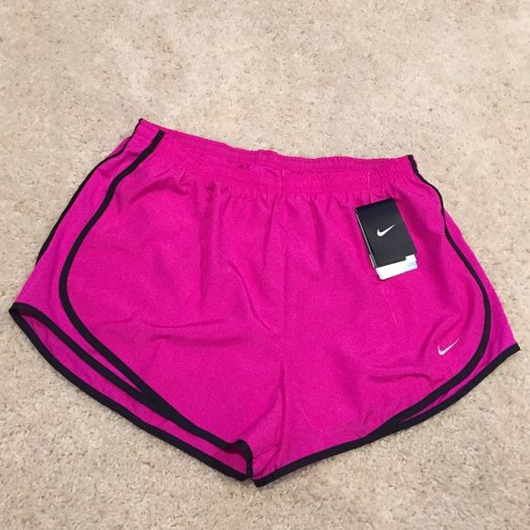 Nike Running shorts Brand new with tags! Has interior lining. Bright magenta in color Nike Shorts