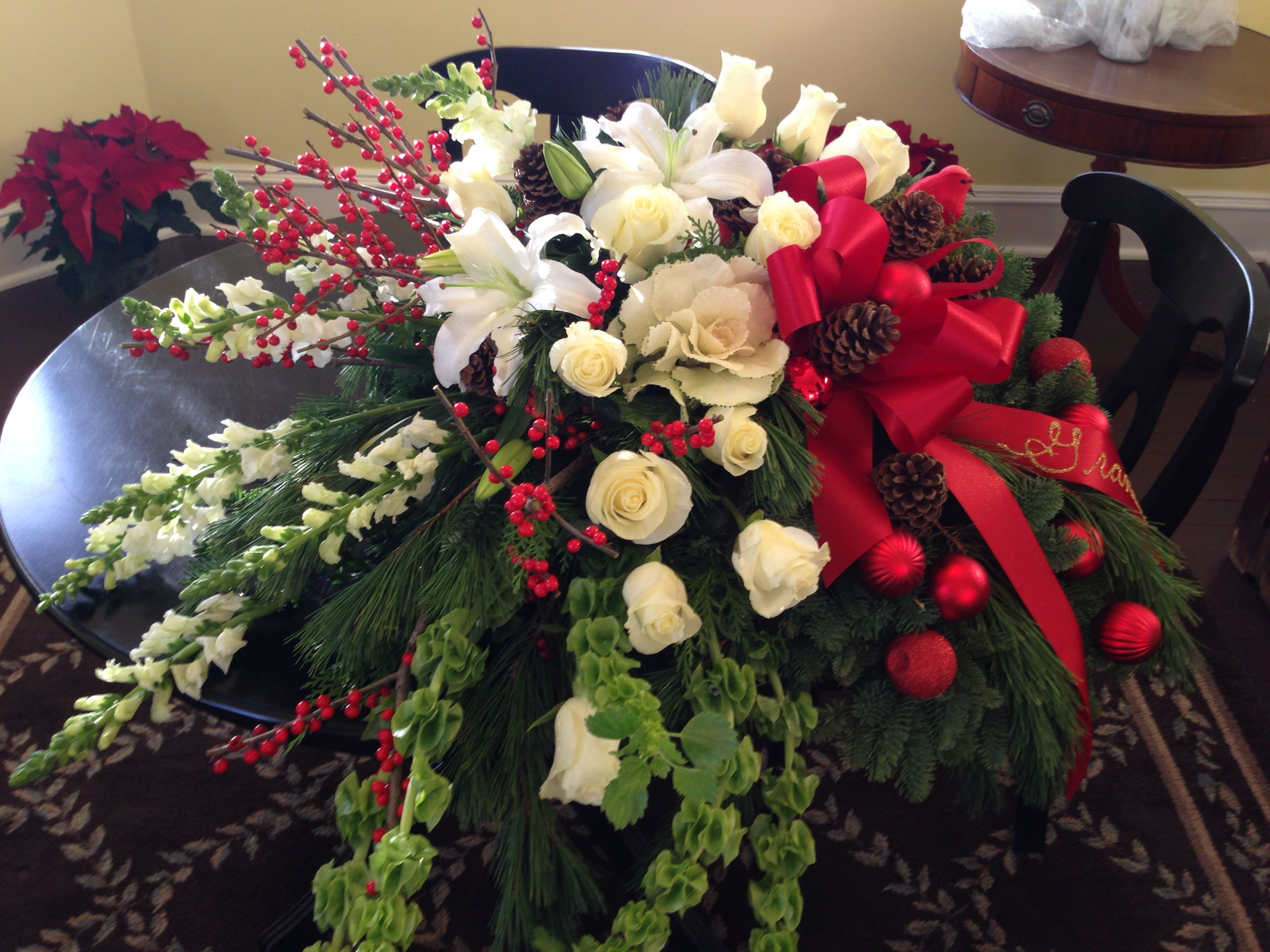 Casket spray christmas theme funerals by flowers on main casket spray christmas theme izmirmasajfo