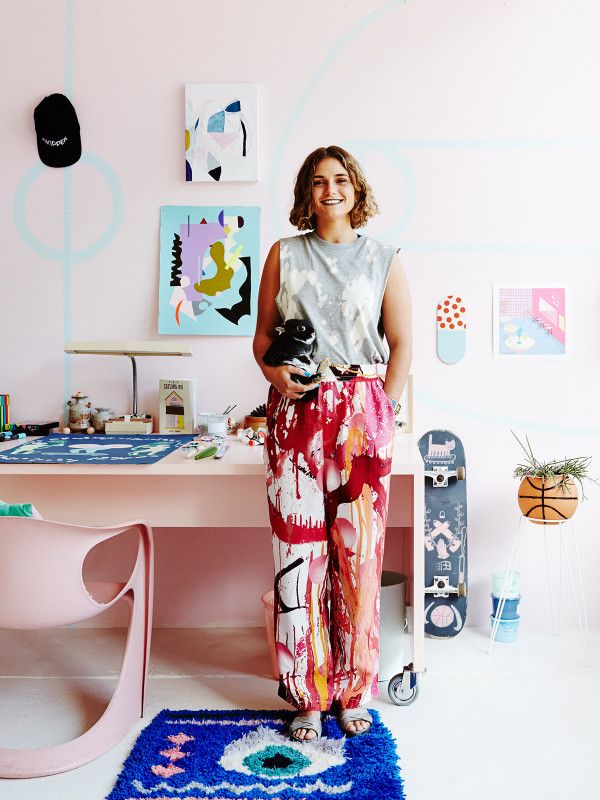 Emerging artist Esther Olsson in the studio with Dinosaur 101 the bunny rabbit! Photo – Annette O'Brien for The Design Files.